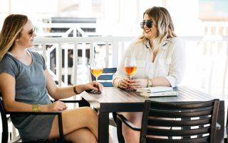 Girls Enjoying Wine on Balcony